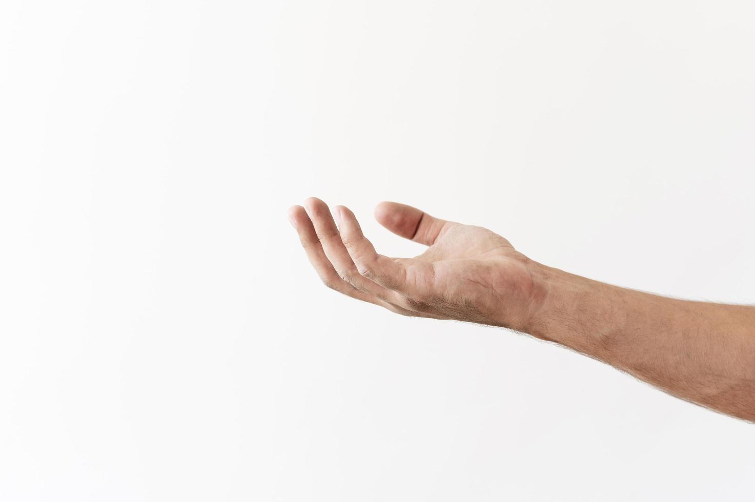 Side view of hand asking for food donations on white background photo