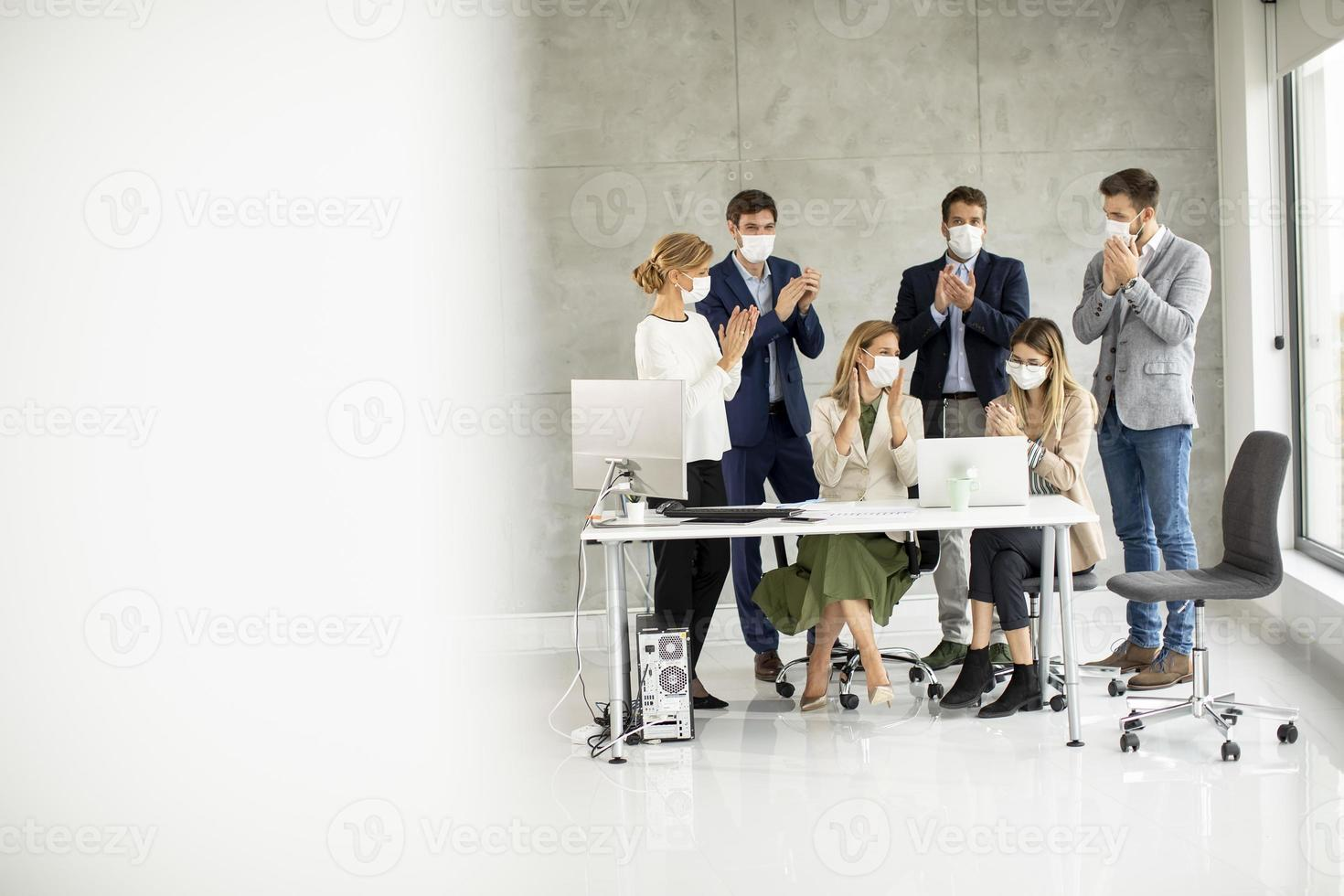View of masked people in a meeting with copy space photo