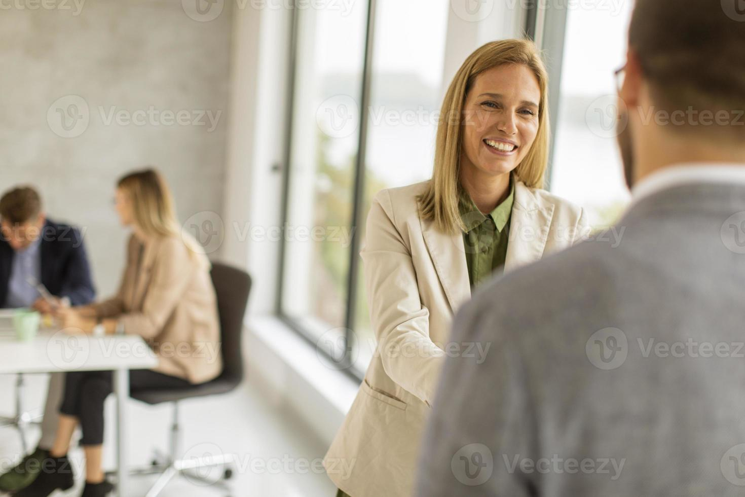 Woman greeting man photo
