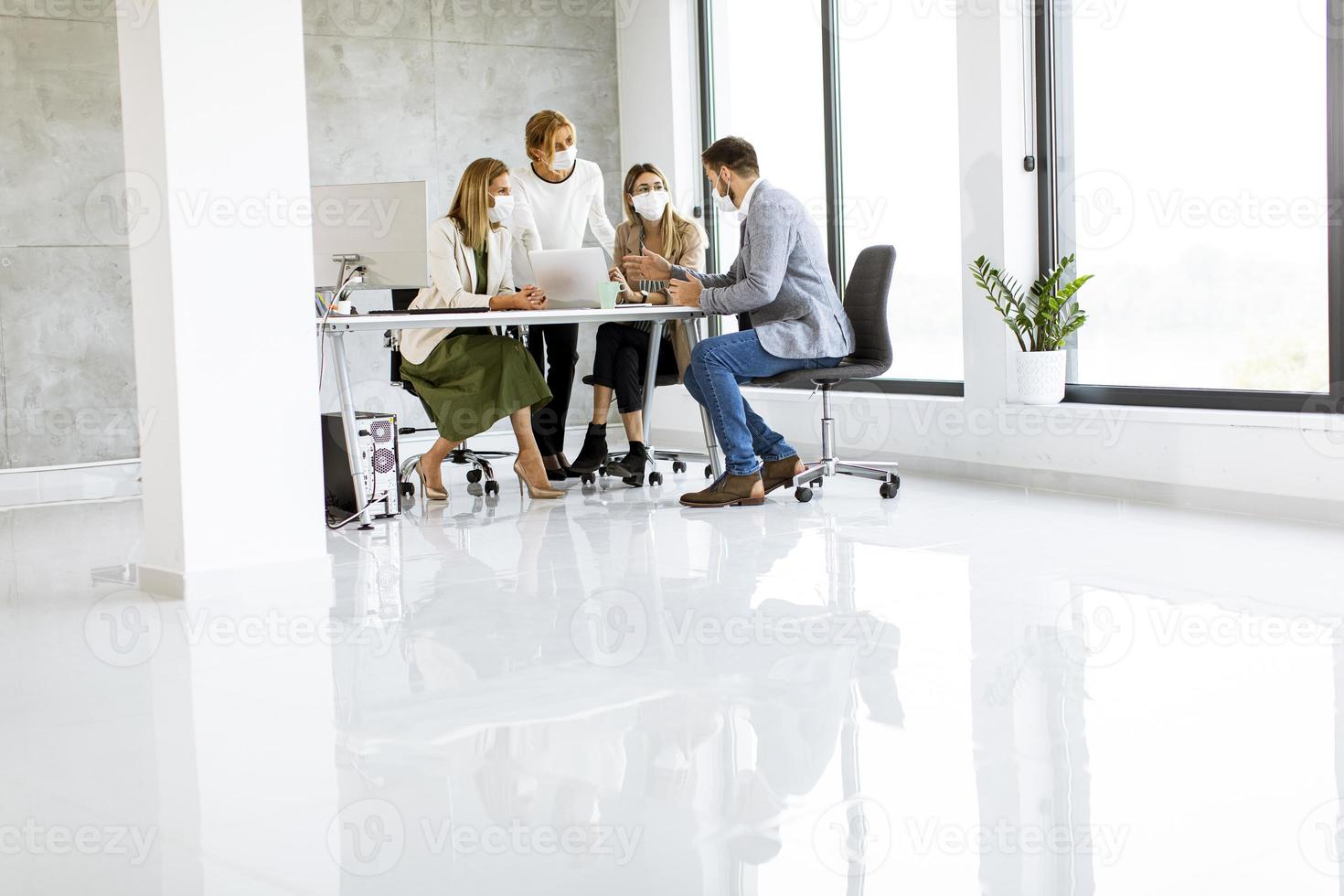 Masked people in a meeting with copy space photo