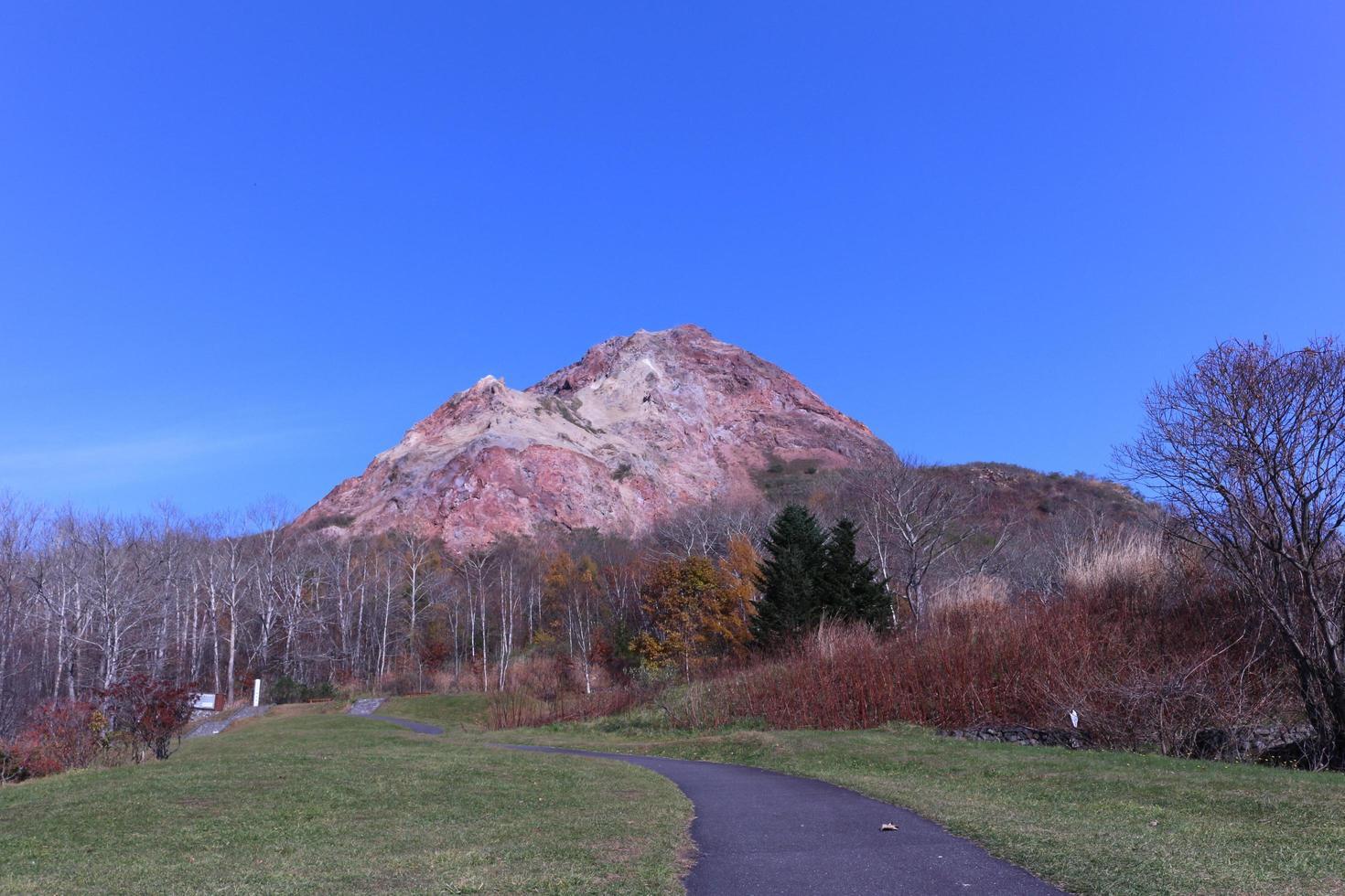 At Mt Showa Shinzan active volcano with blue sky in Hokkaido photo