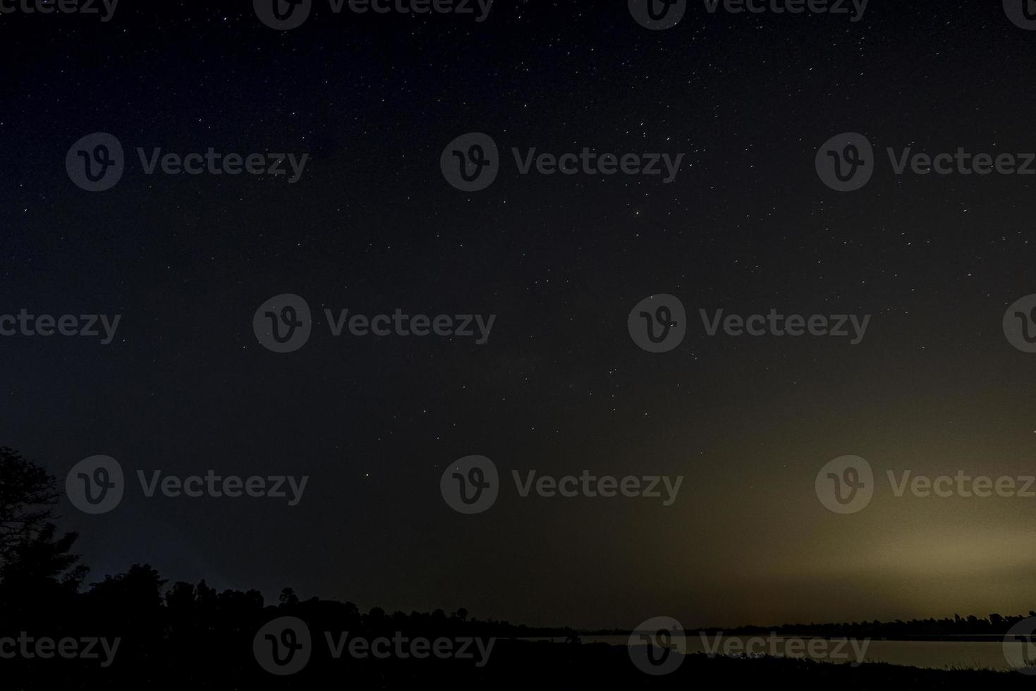 Milky way galaxy with stars on a night sky background photo