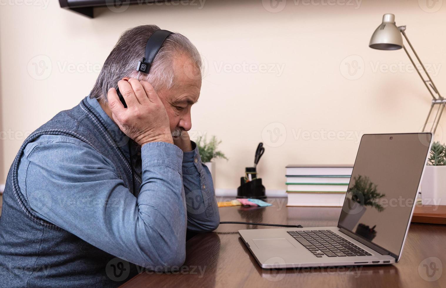 Senior man listening to music photo