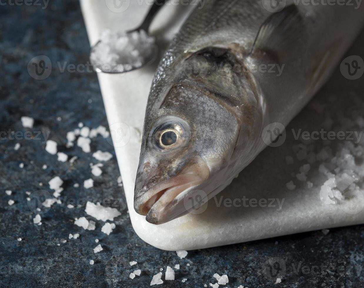 Raw fish arrangement for cooking photo