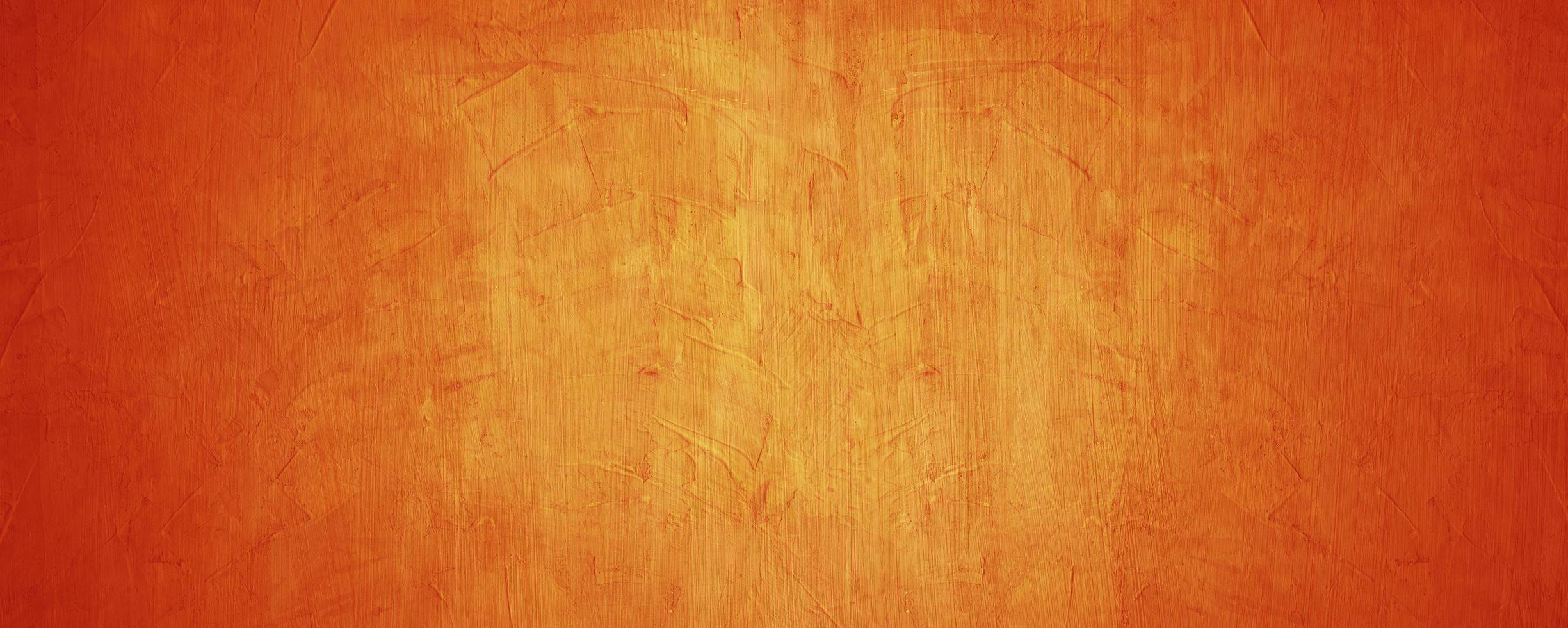 Horizontal yellow and orange grunge texture cement or concrete wall banner blank background photo