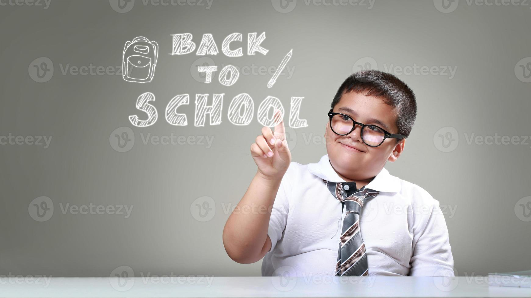 The boy pointing back to school photo