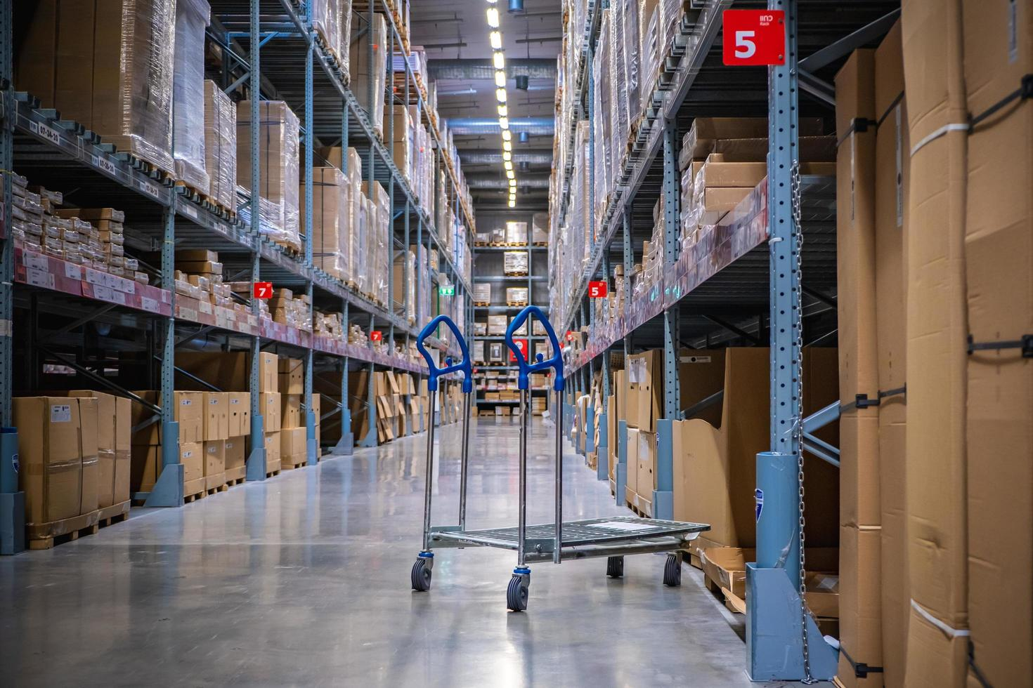A cart in warehouse aisle in an IKEA store photo