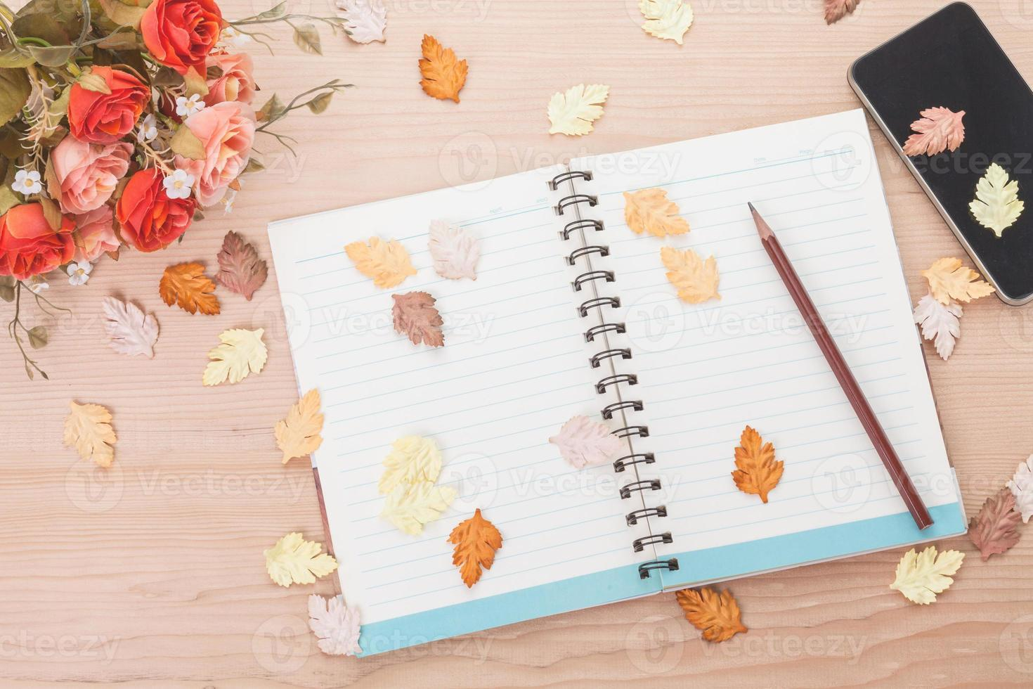 Spiral notebook on wood background photo