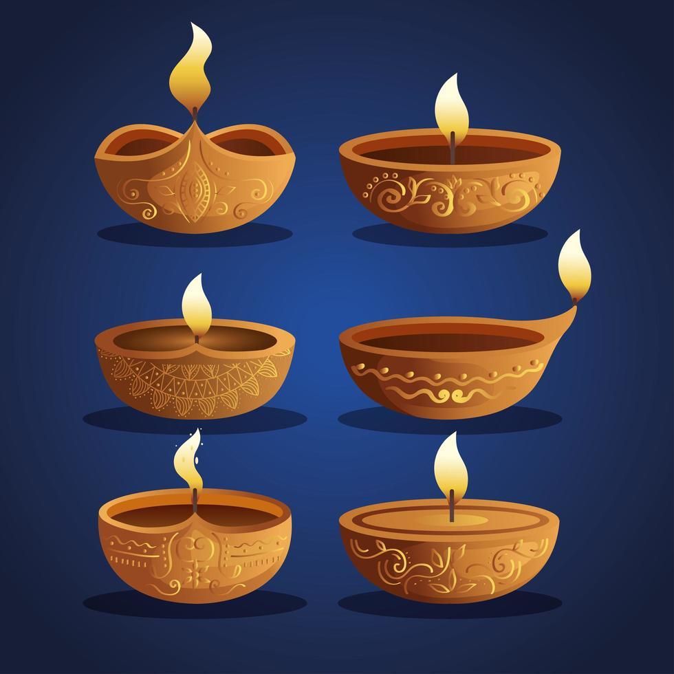 Happy diwali diya candles set on blue background vector design