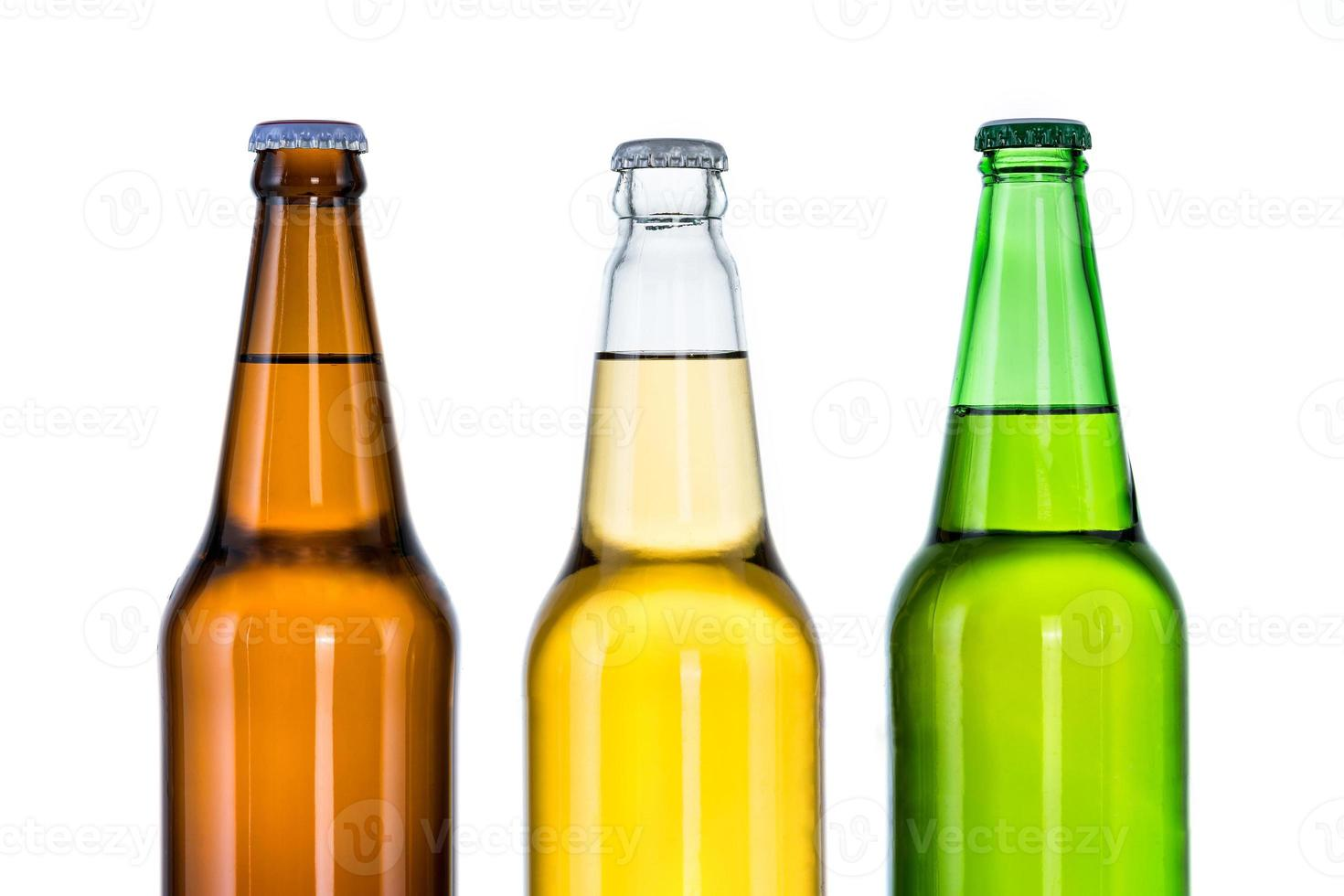 Group of Three bottles of beer isolated on white background photo