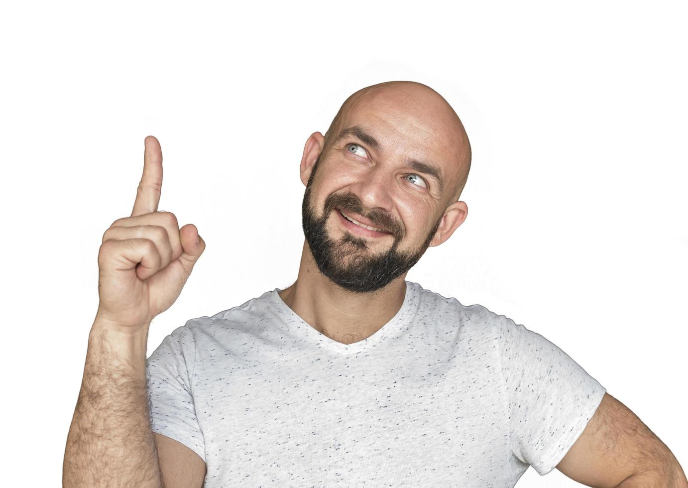 Portrait Of white bald man with beard in white t shirt smiling and showing thumb up isolate on a white background photo