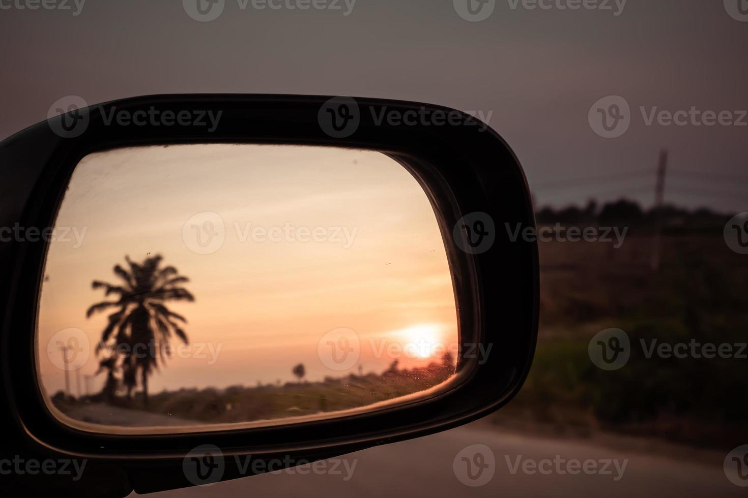 Car driving through field blur viewed from outside driver windowat sunset concept idea background photo