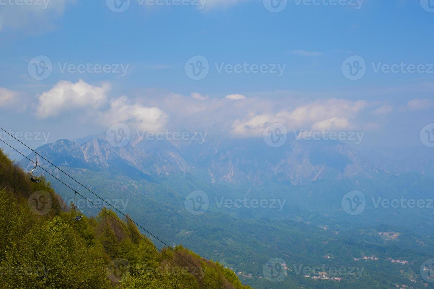 Clouds above mountains photo