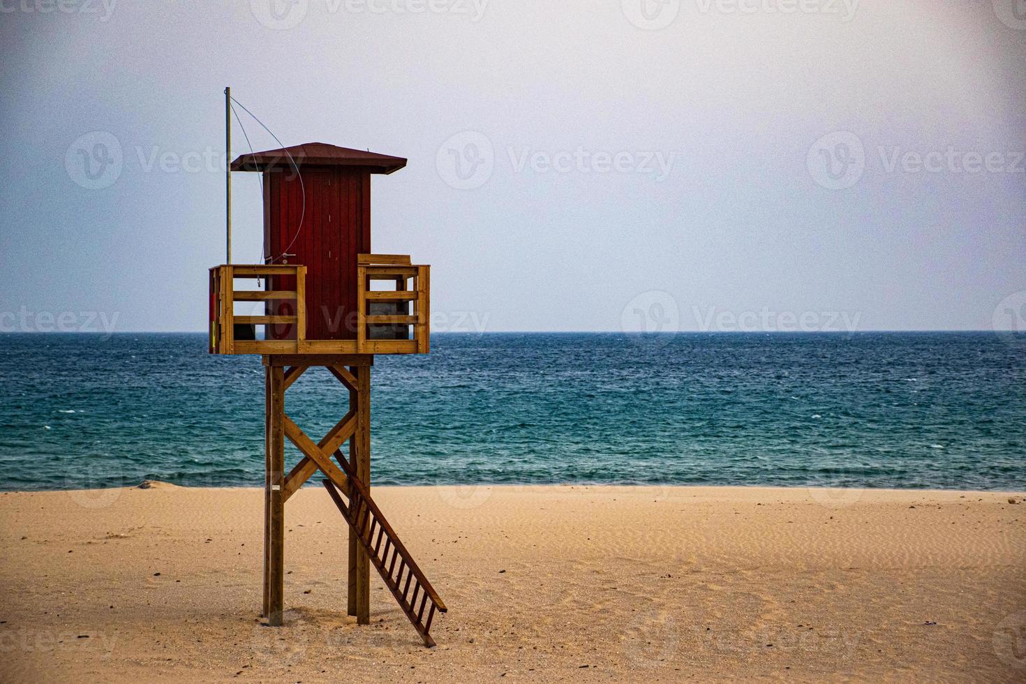 Lifeguard hut and beach photo