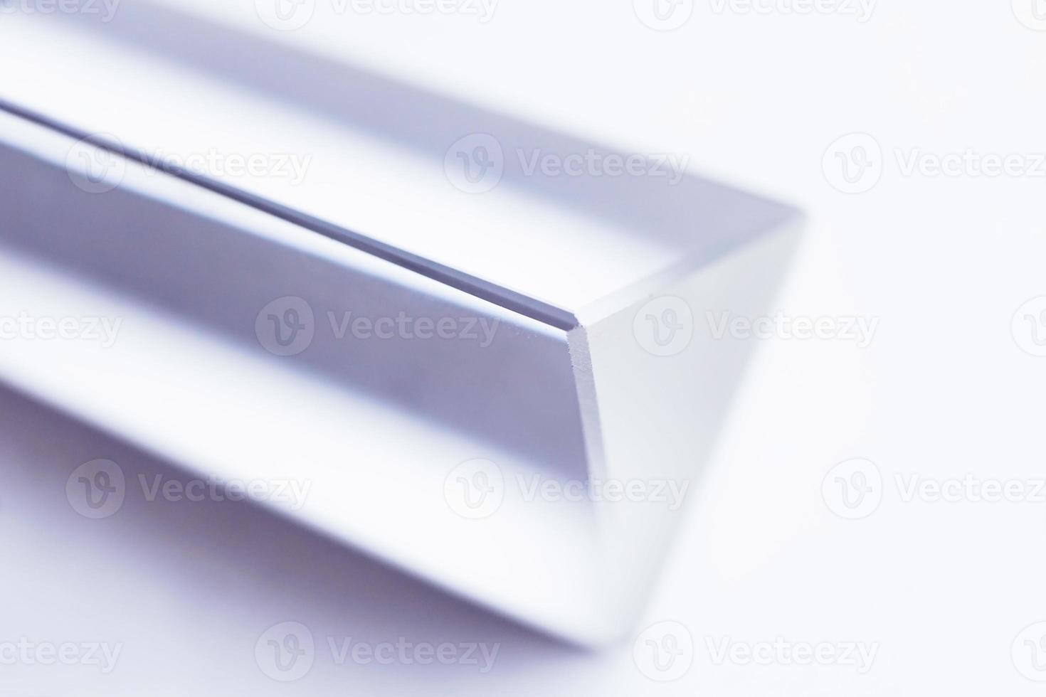 An amazing and beautiful macro with space and clearness about a crystal prism on white background photo