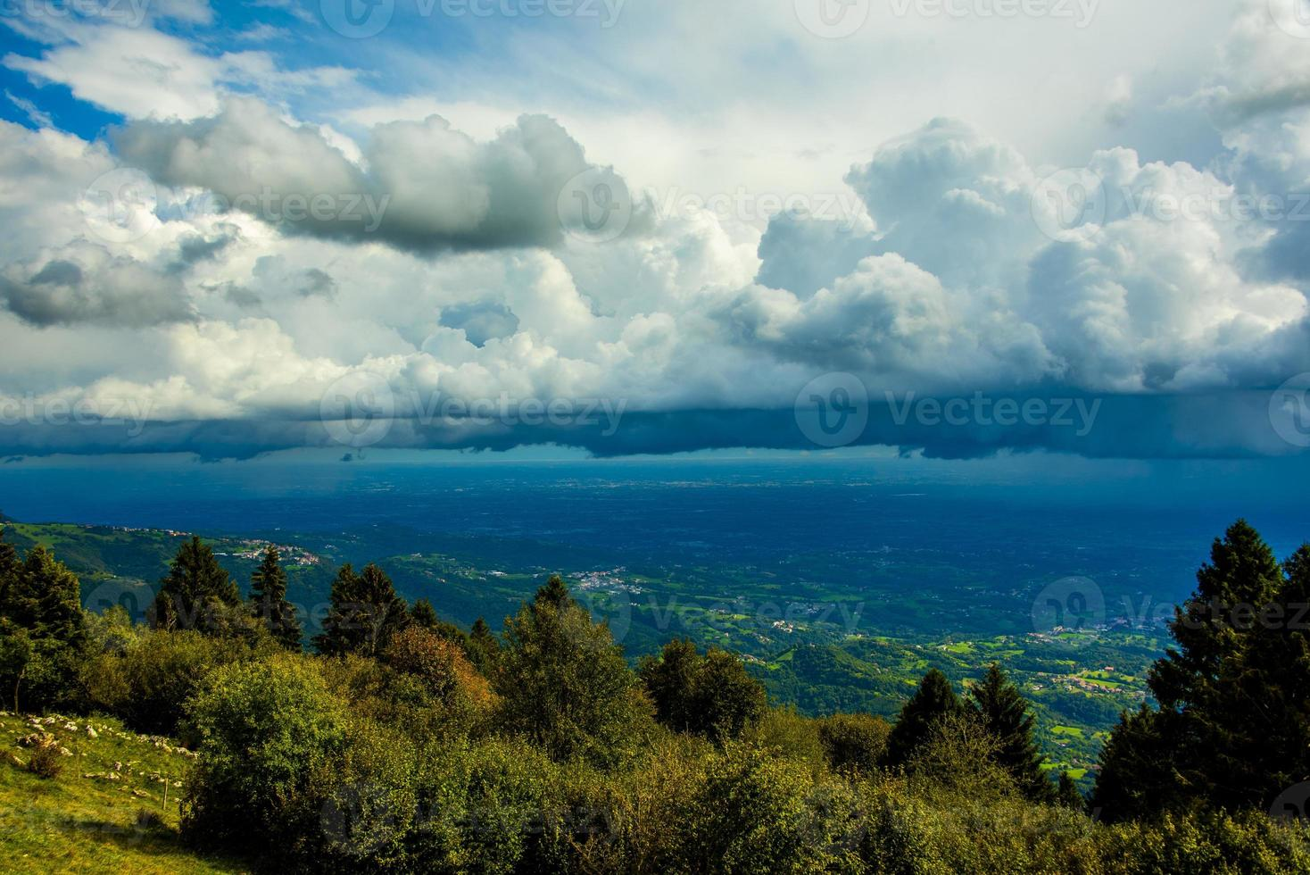 Clouds above trees photo