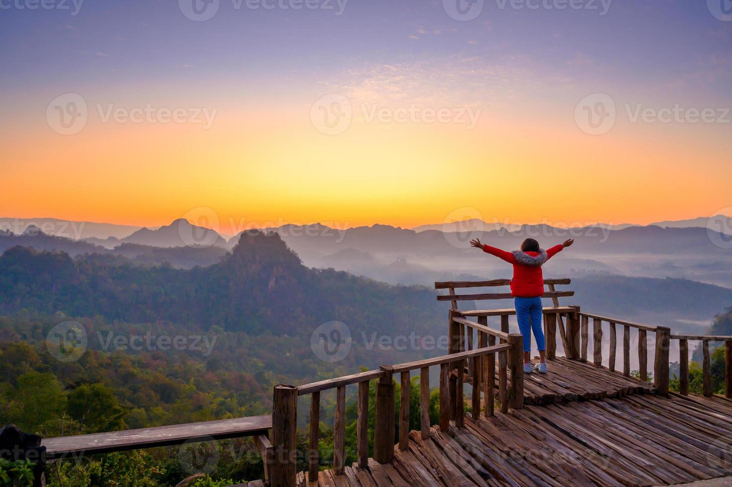 Young people are feeling the cool morning air with a sea of mist in front of Mae Hong Son Baan Jabo Thailand photo