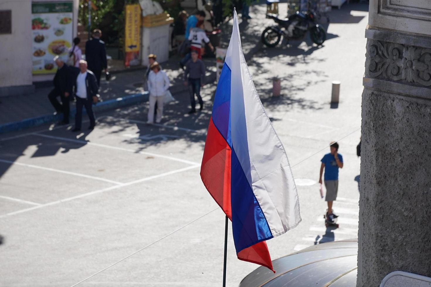 Russian flag on a blurry street background photo