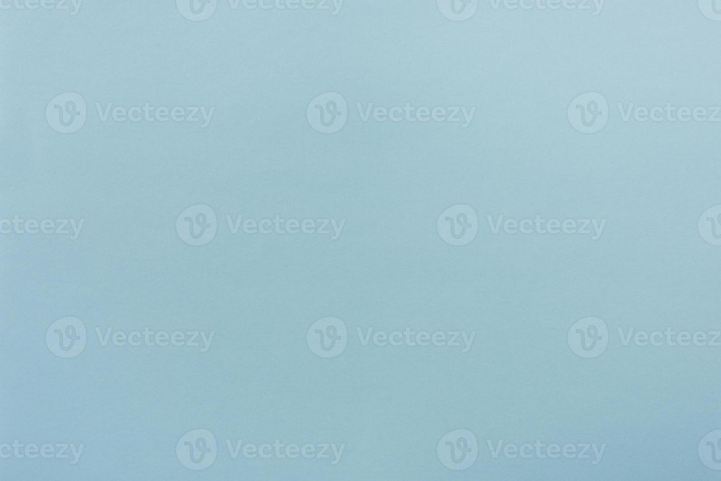 Blue paper with soft texture. Simple background. photo