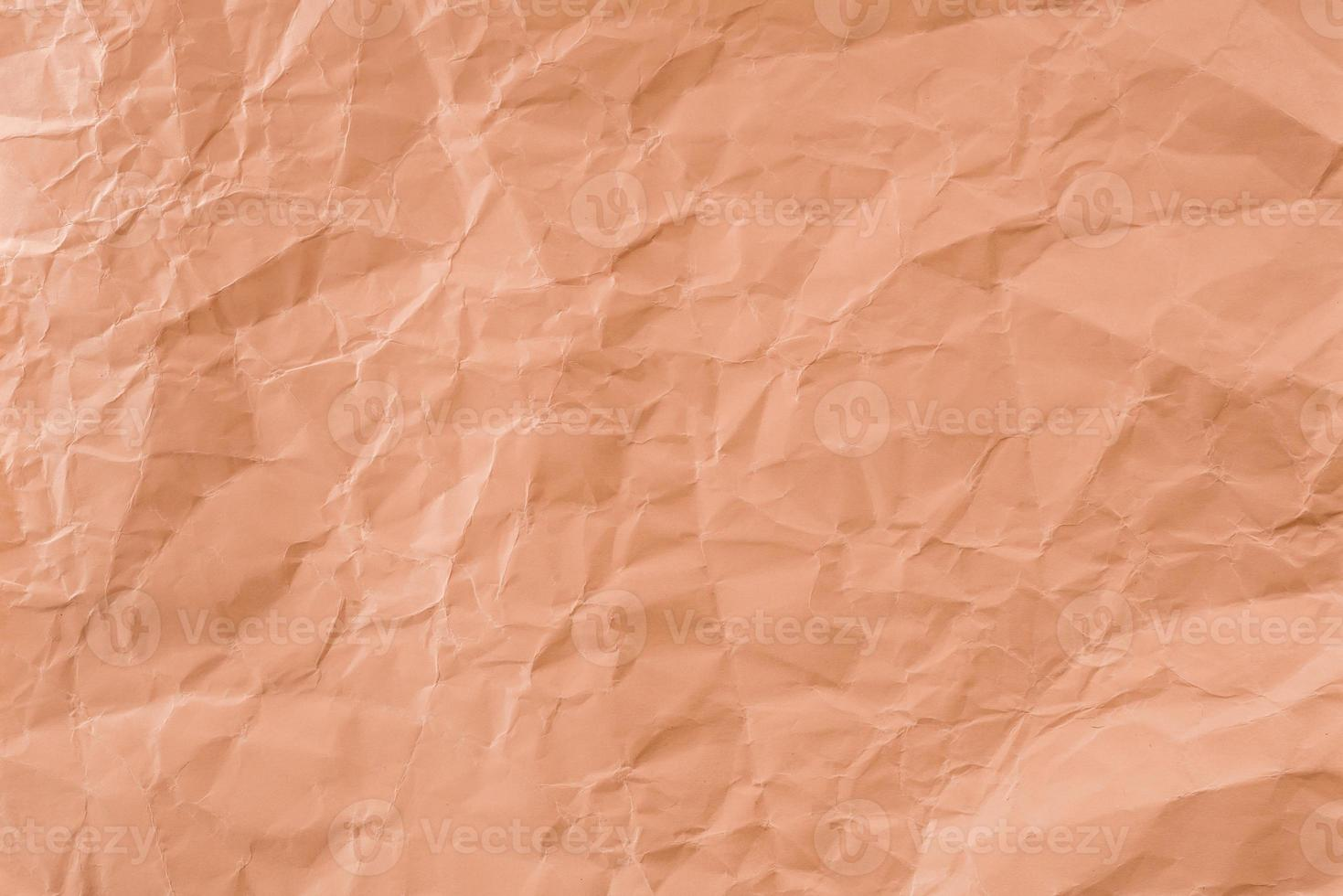 Crumpled Orange paper with soft texture. Simple background. photo