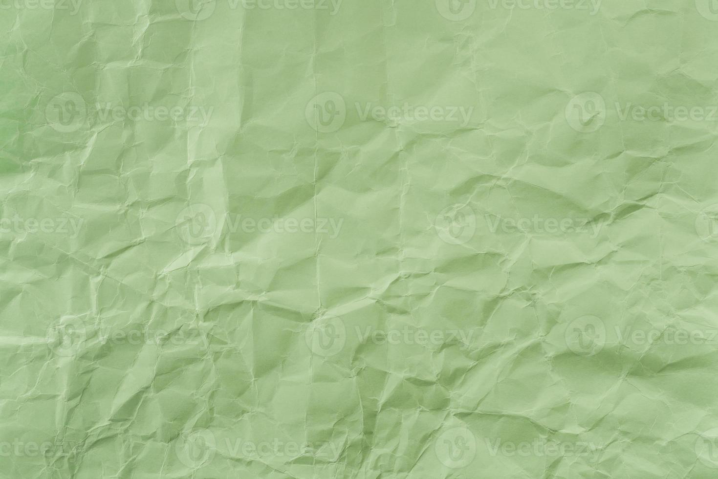 papel verde arrugado con textura suave. fondo simple. foto