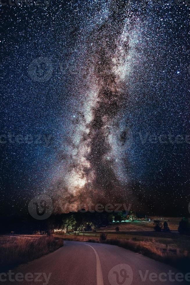 Milky Way galaxy over the forest road. Milky Way galaxy over the mountain forest road, Rajac, Serbia. The night sky is astronomically accurate. photo