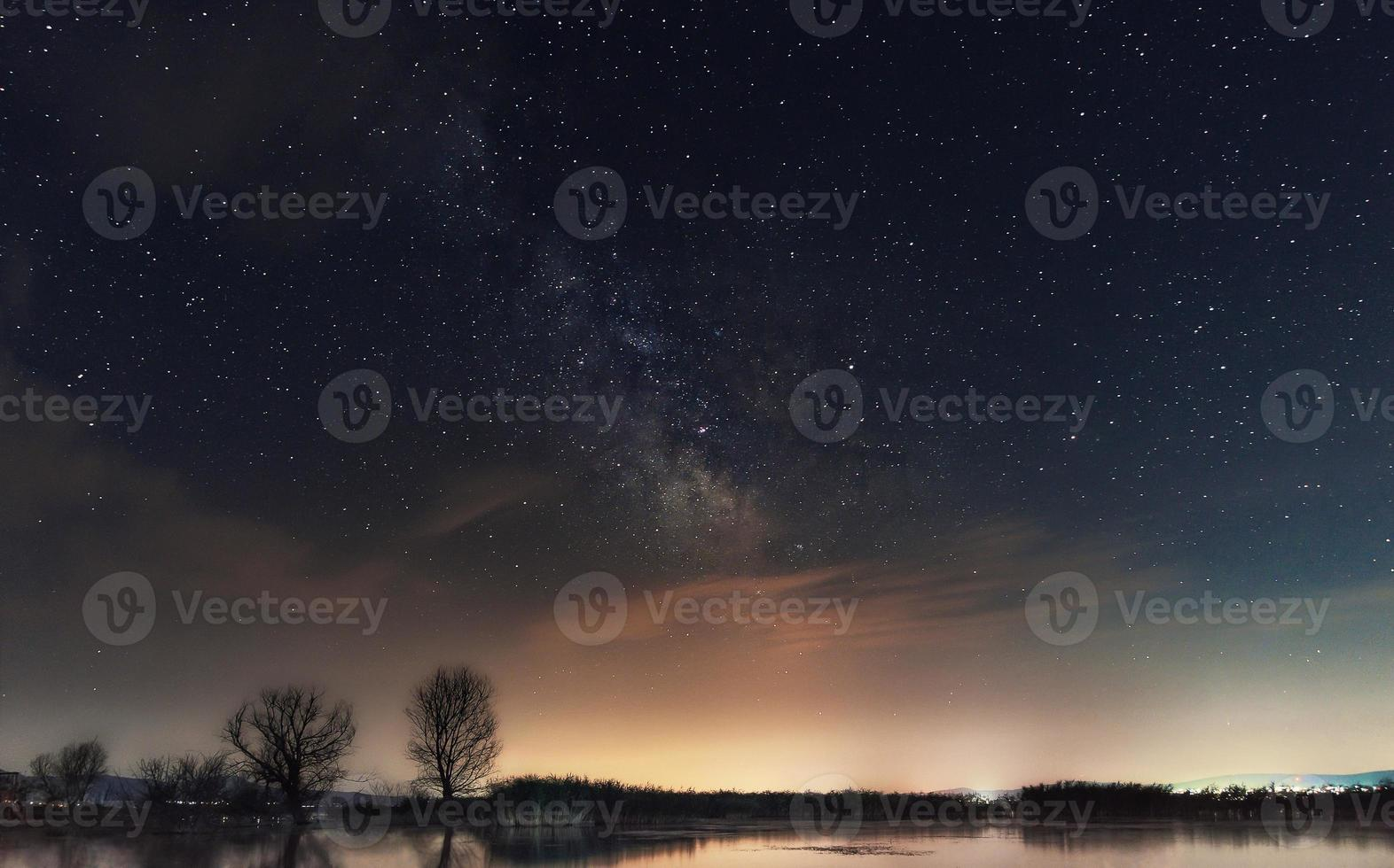 Milky Way over the lake. Milky Way galaxy over the Dojran Lake, FYR Macedonia, South Macedonia. The night sky is astronomically accurate. photo