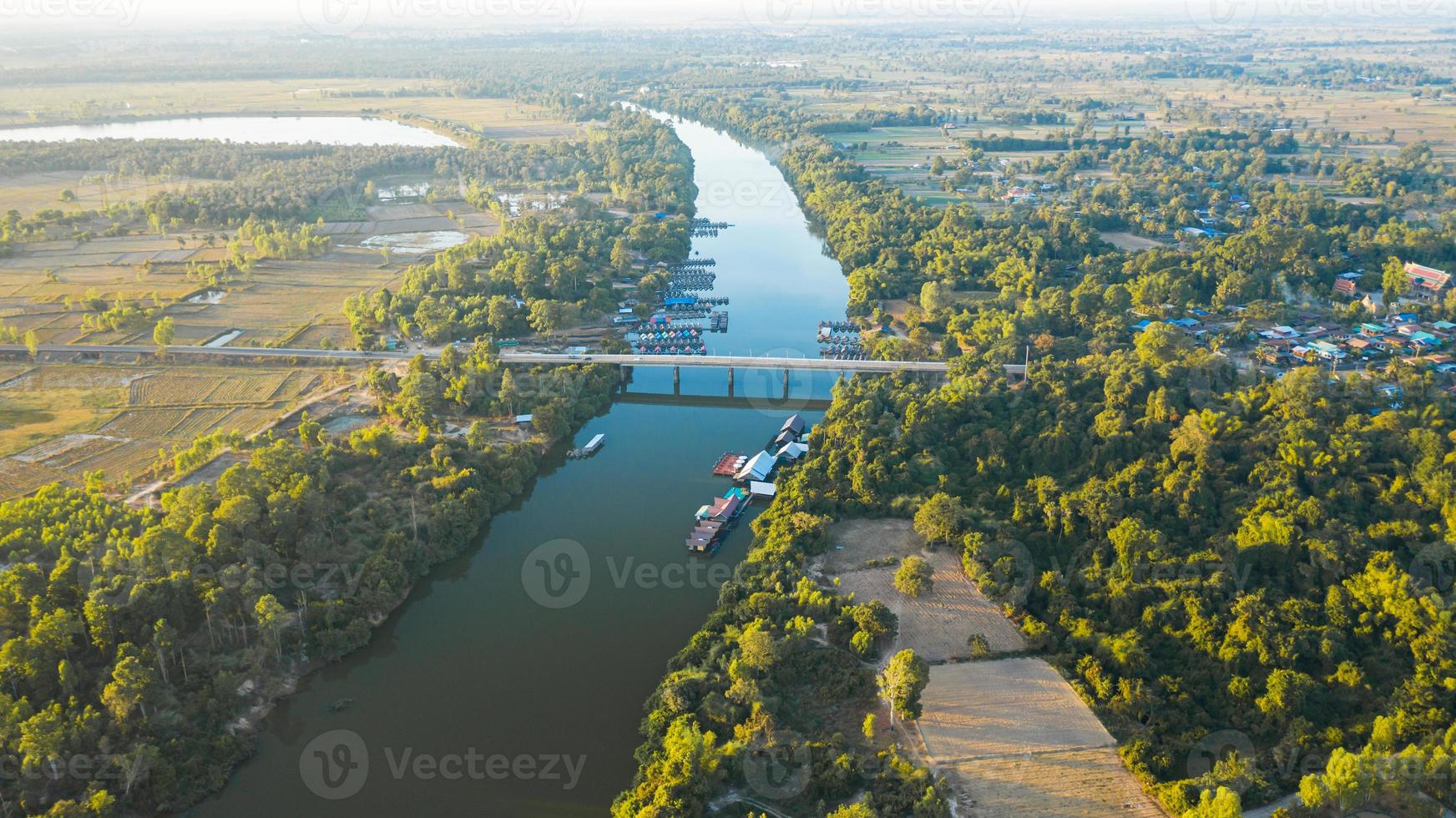 Scenic aerial view of the river bridge in rural Thailand photo
