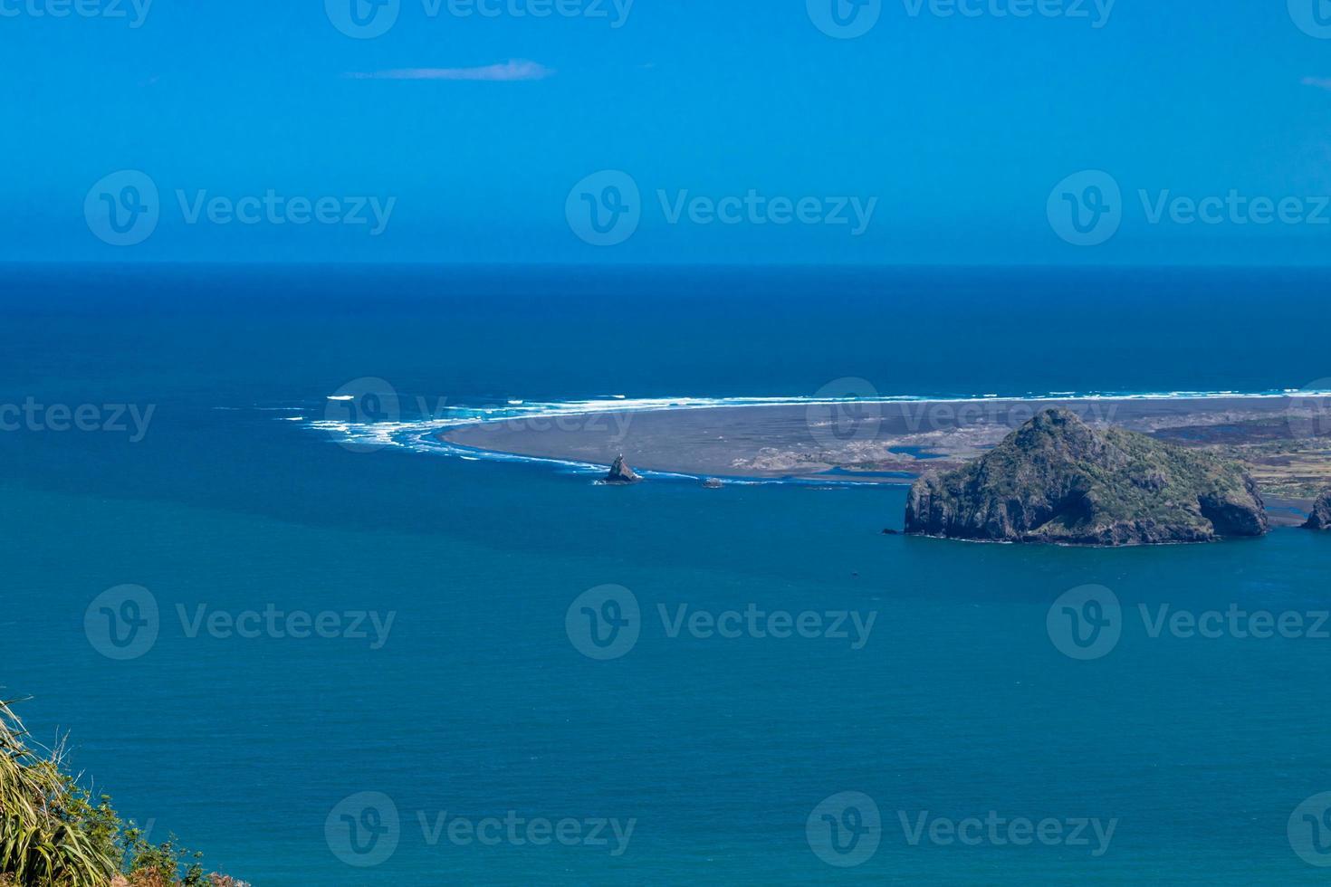 Waves role ashore on the South Head. Manakua Heads, Auckland, New Zealand photo