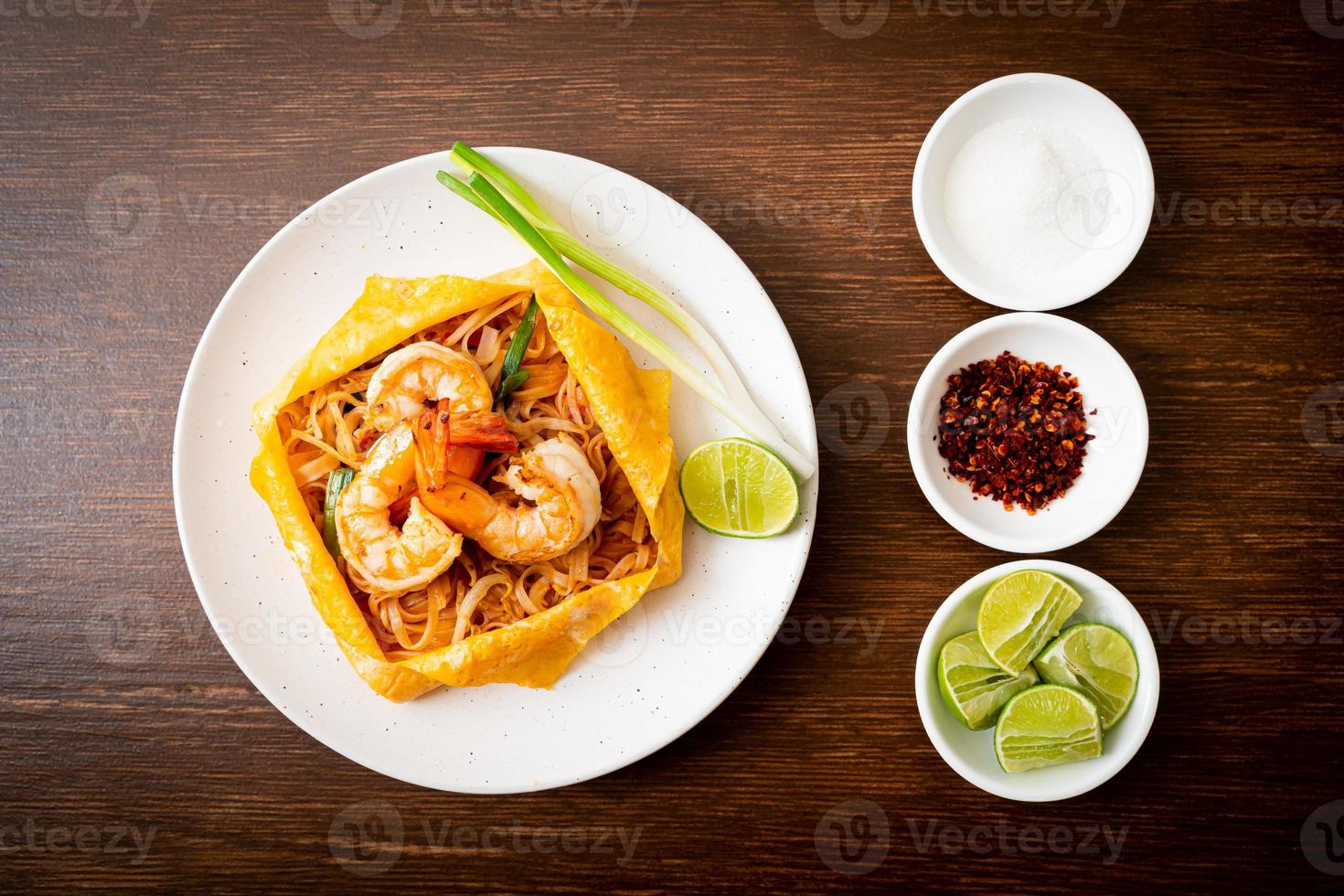 Thai stir fried noodles with shrimps and egg wrap or Pad Thai photo