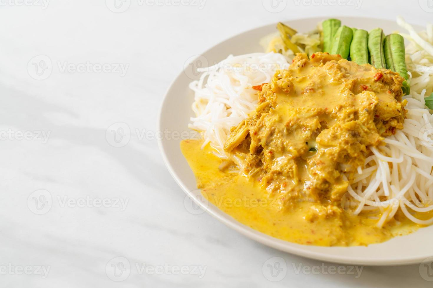 Thai Rice Noodles with Crab Curry and Variety Vegetables photo