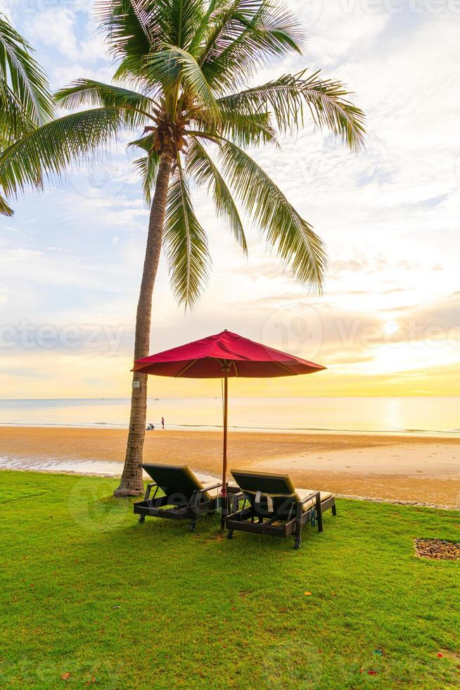 Umbrella with chair with sea beach background and sunrise in morning photo