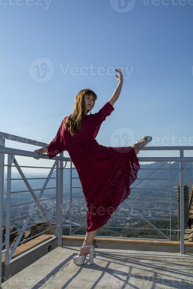 long haired girl dancing outdoors photo