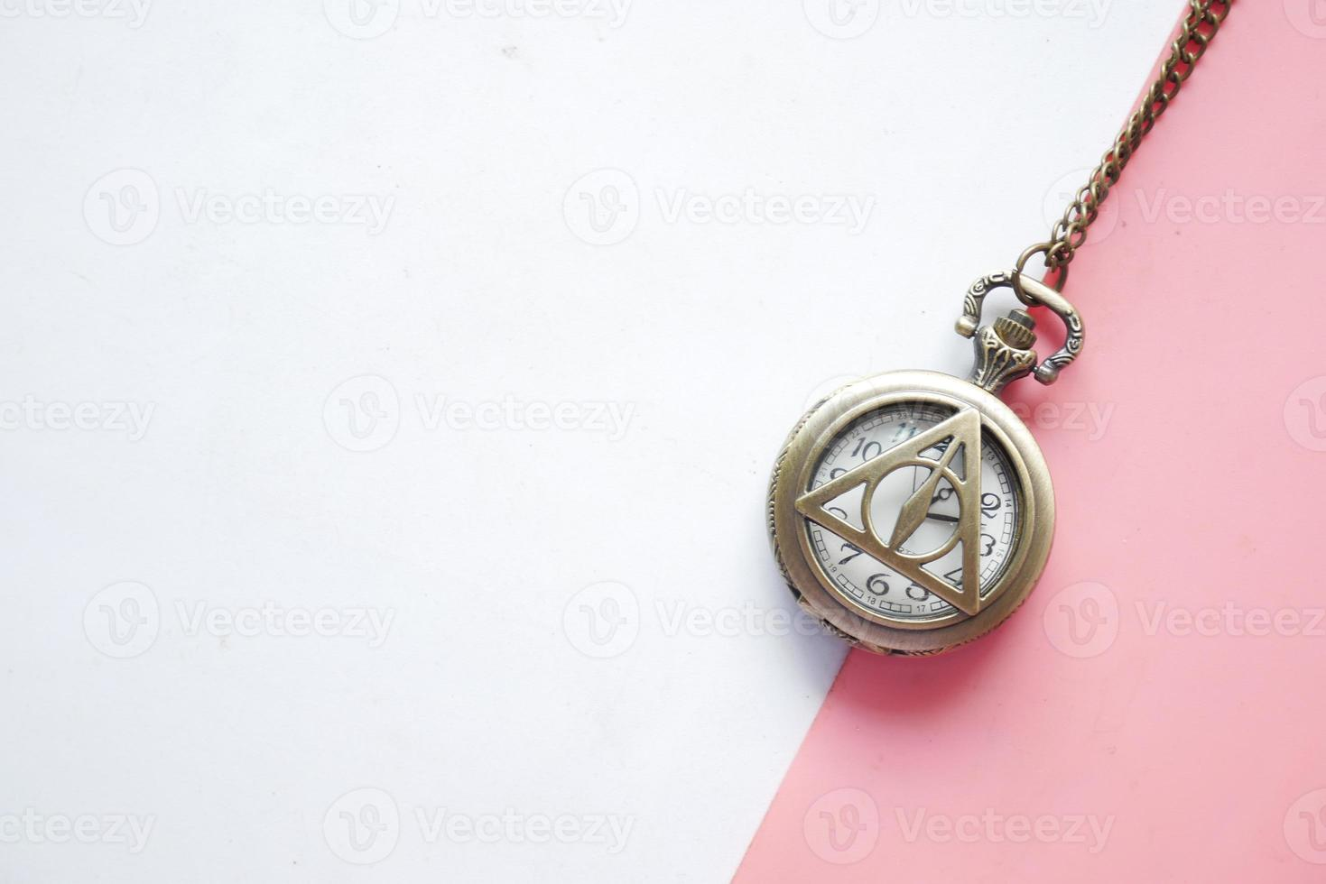 Old clock on color block background photo