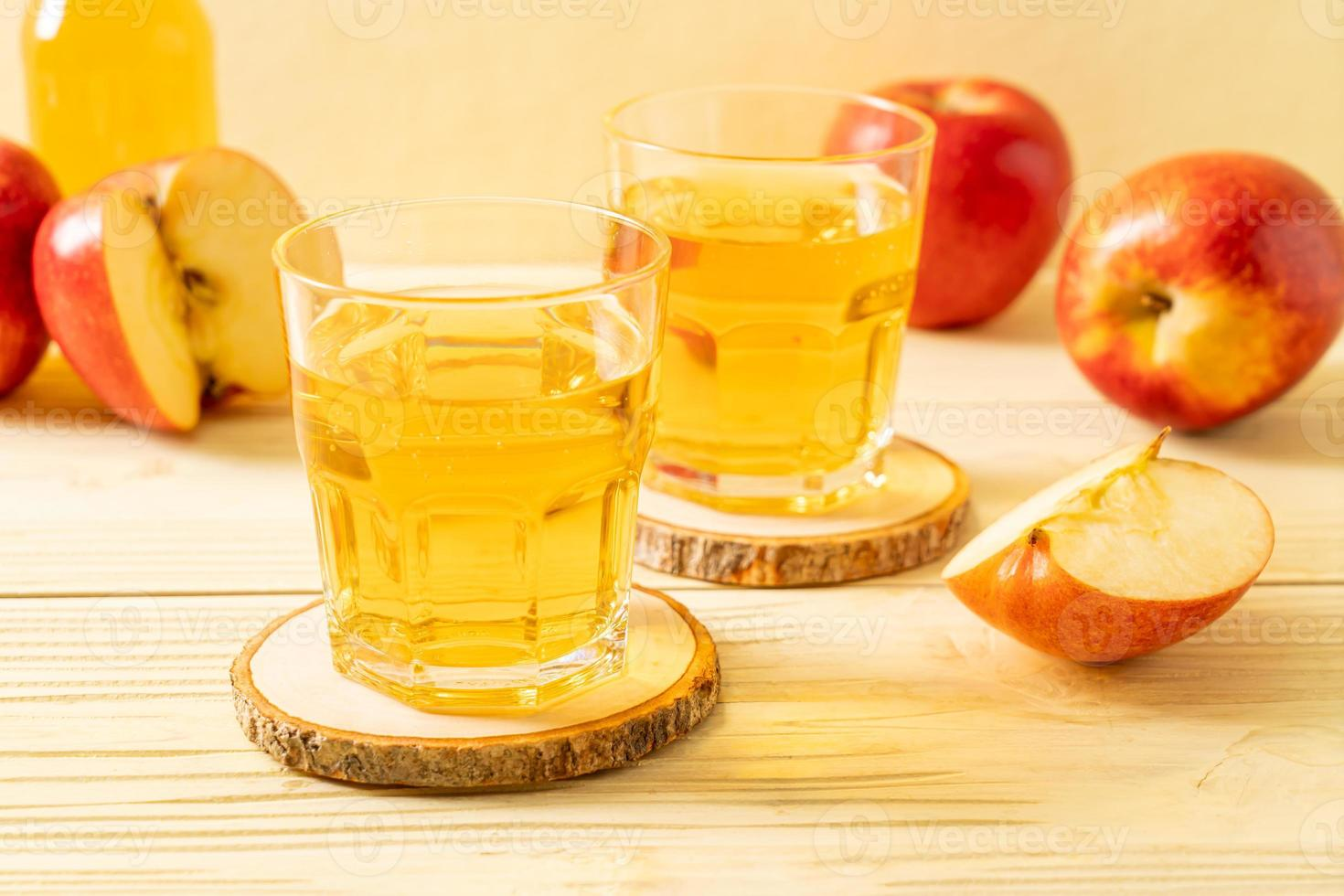 Apple juice with red apples fruits photo
