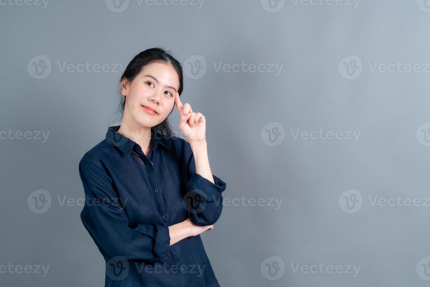 Beautiful and young Asian woman thinking photo