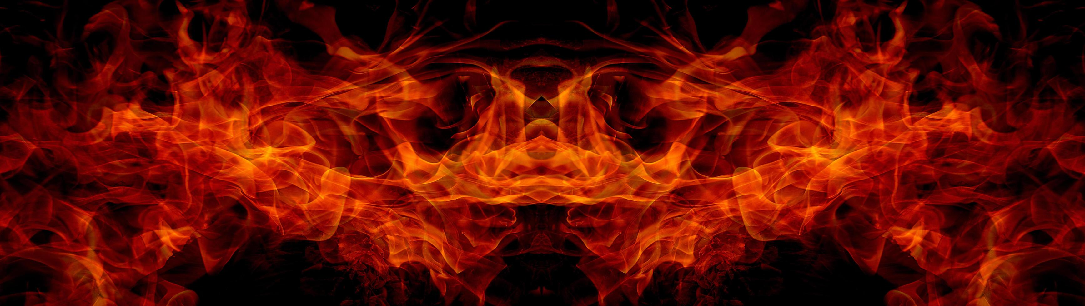 Fire flames on abstract art black background, burning red hot sparks rise, fiery orange glowing flying particles photo