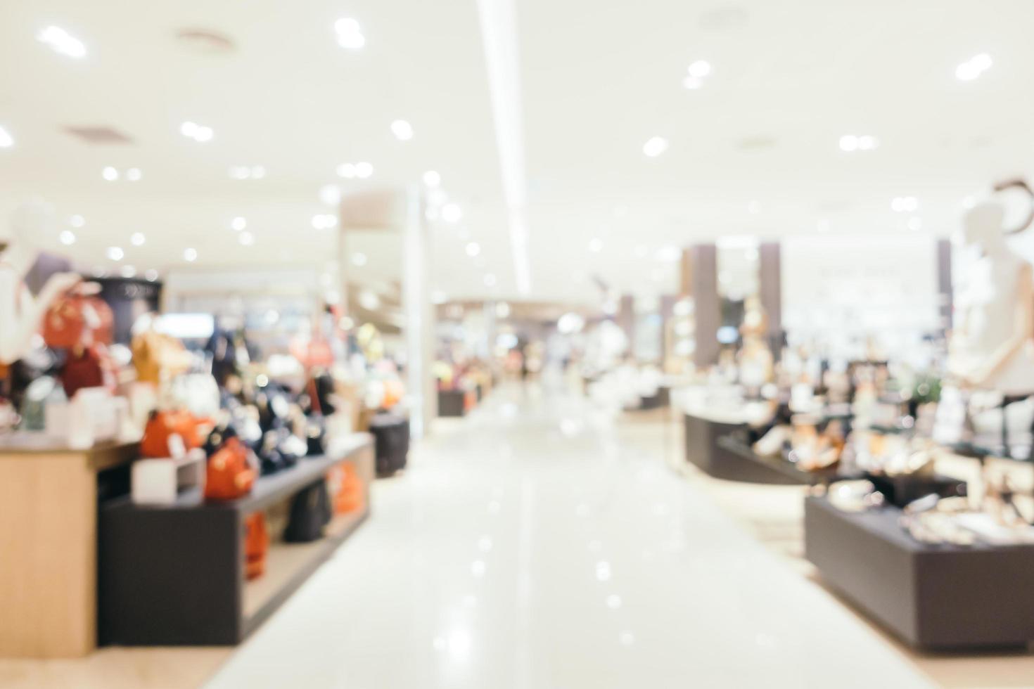 Desenfoque abstracto y centro comercial desenfocado del interior de la tienda deparment foto