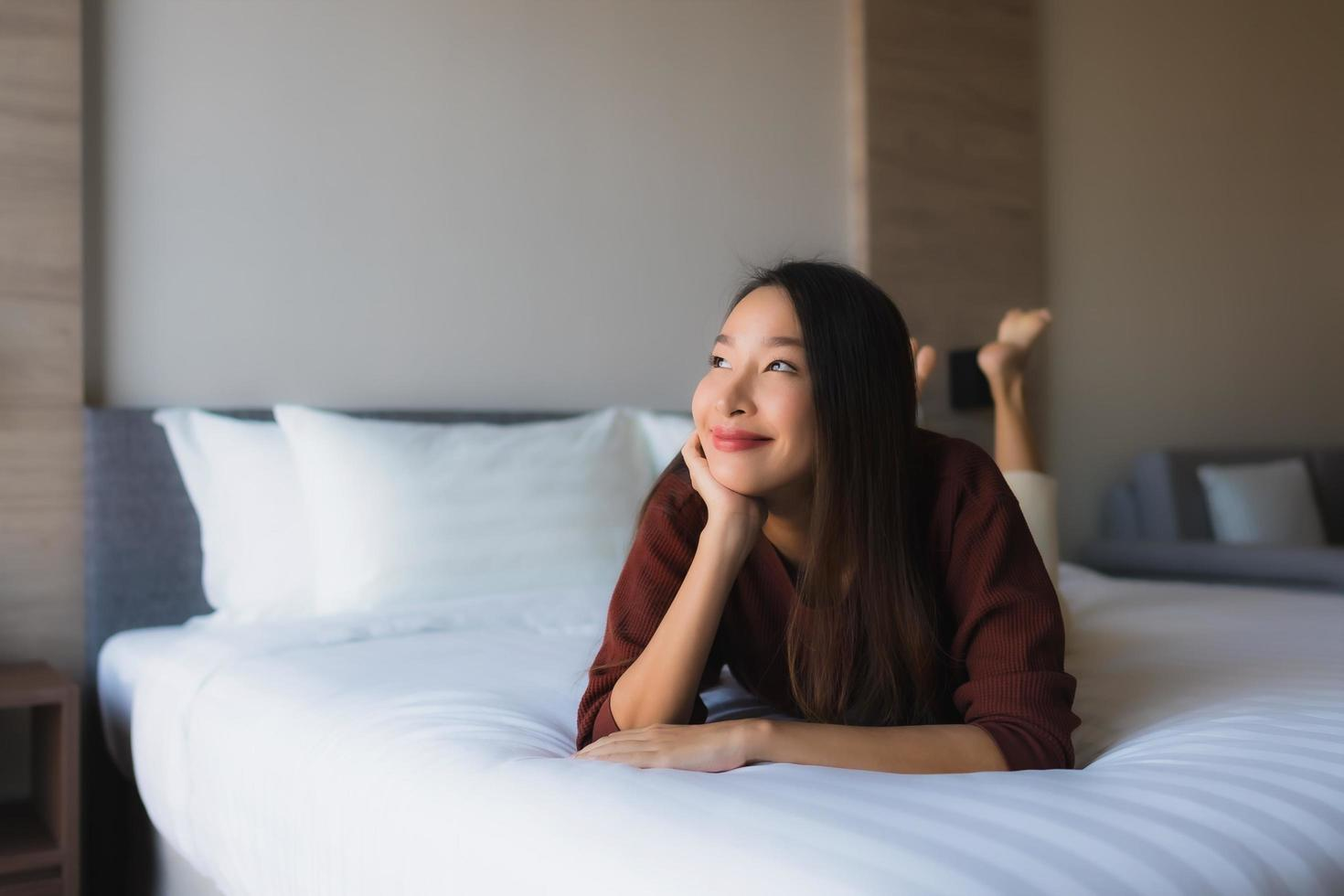 Portrait beautiful young asian women happy smile relax on bed photo