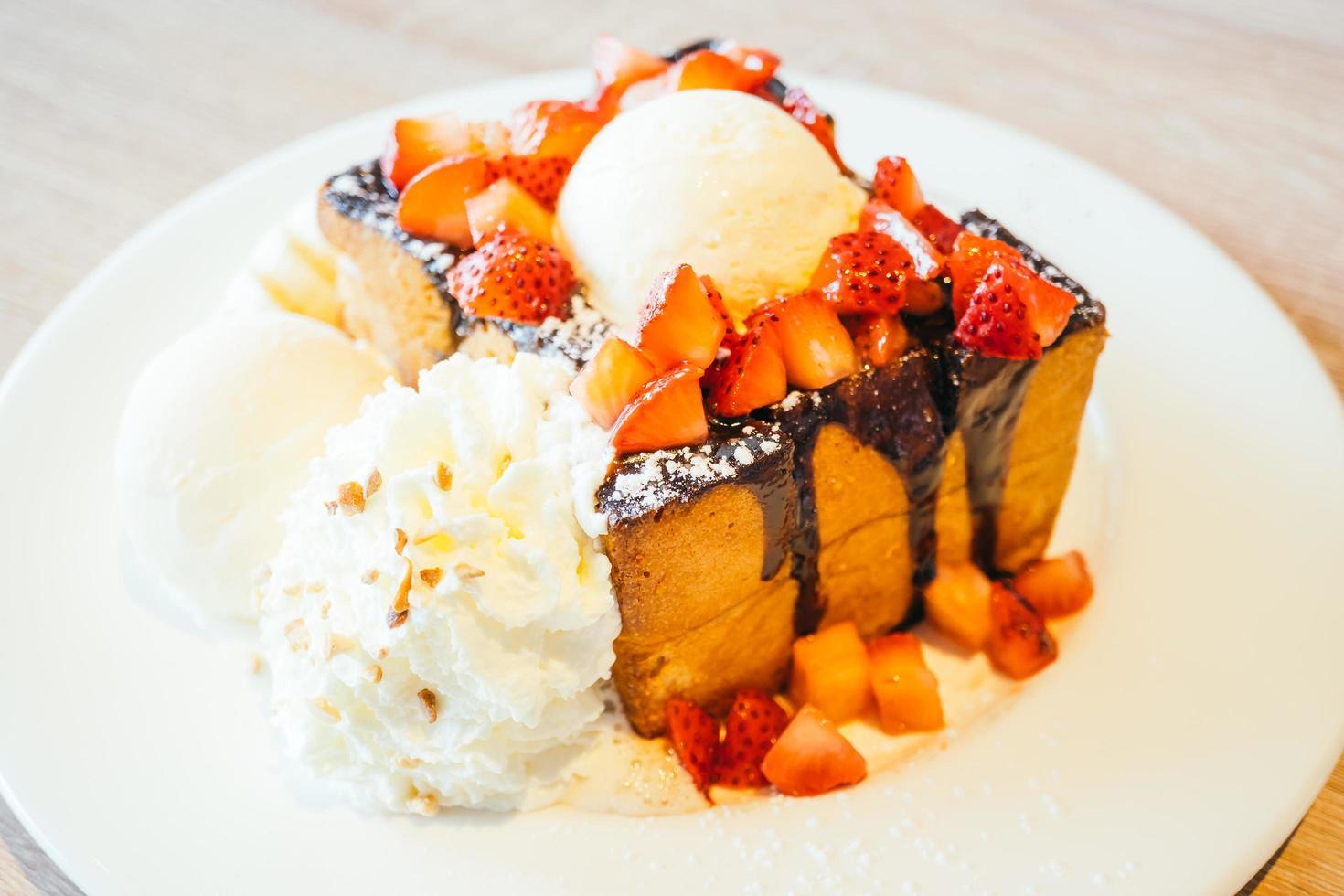 Honey toast with ice cream and strawberry and banana photo