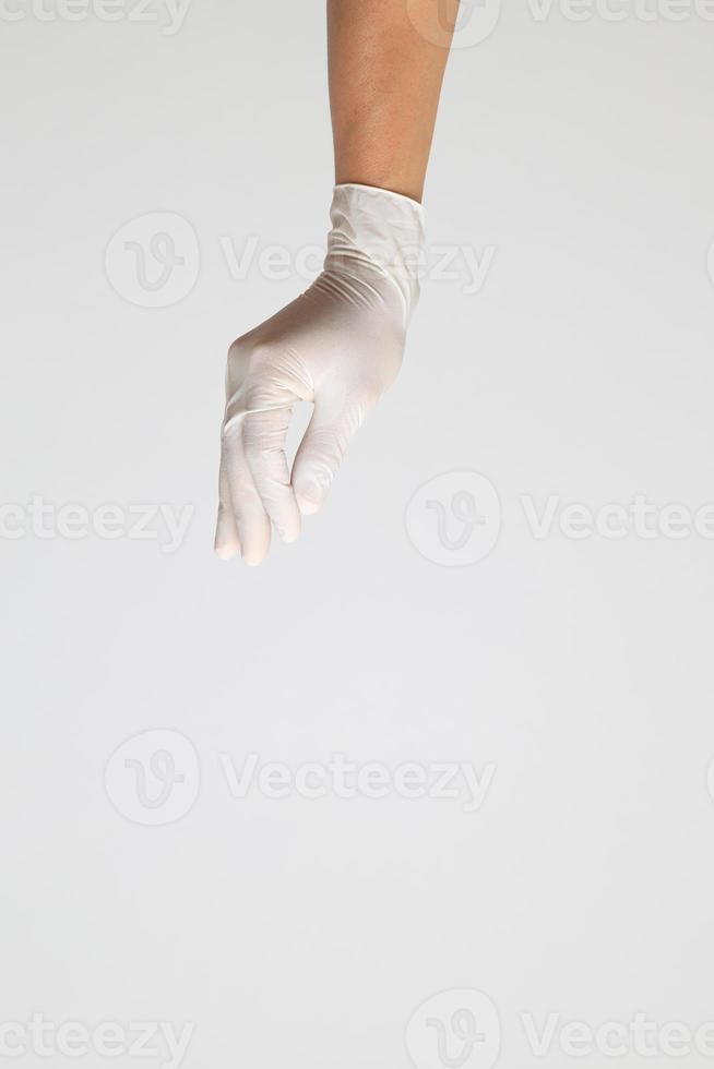 mano con guantes médicos foto