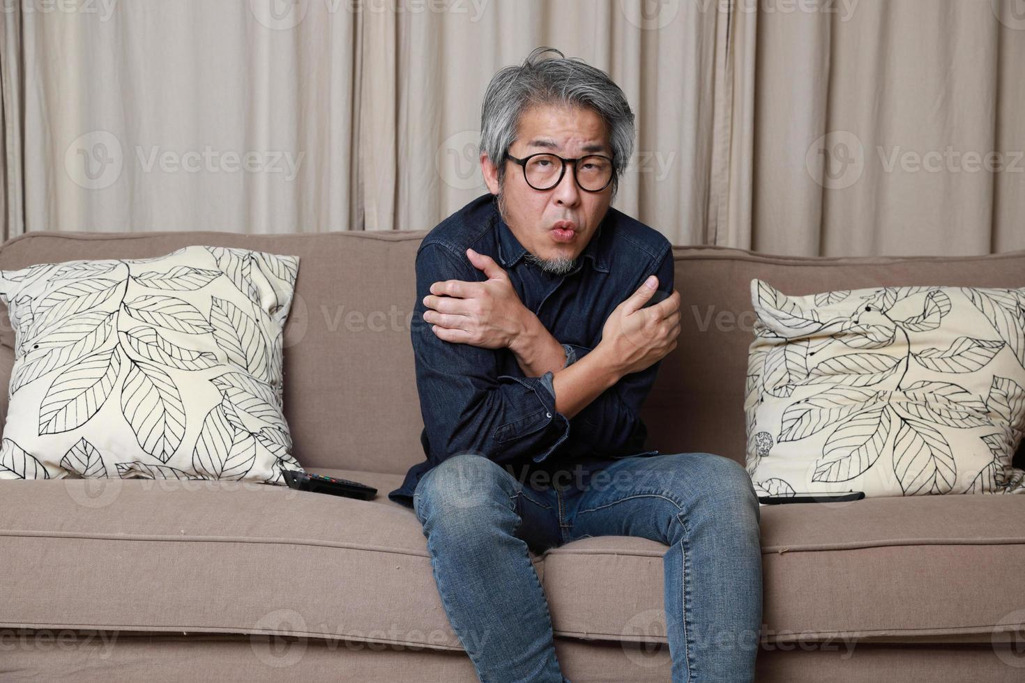 Asian Man in The Living Room photo