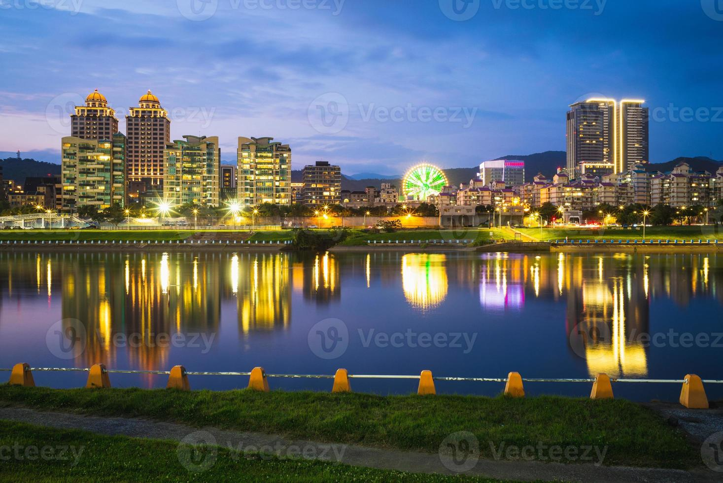 Skyline of Taipei by the river at night in Taiwan photo