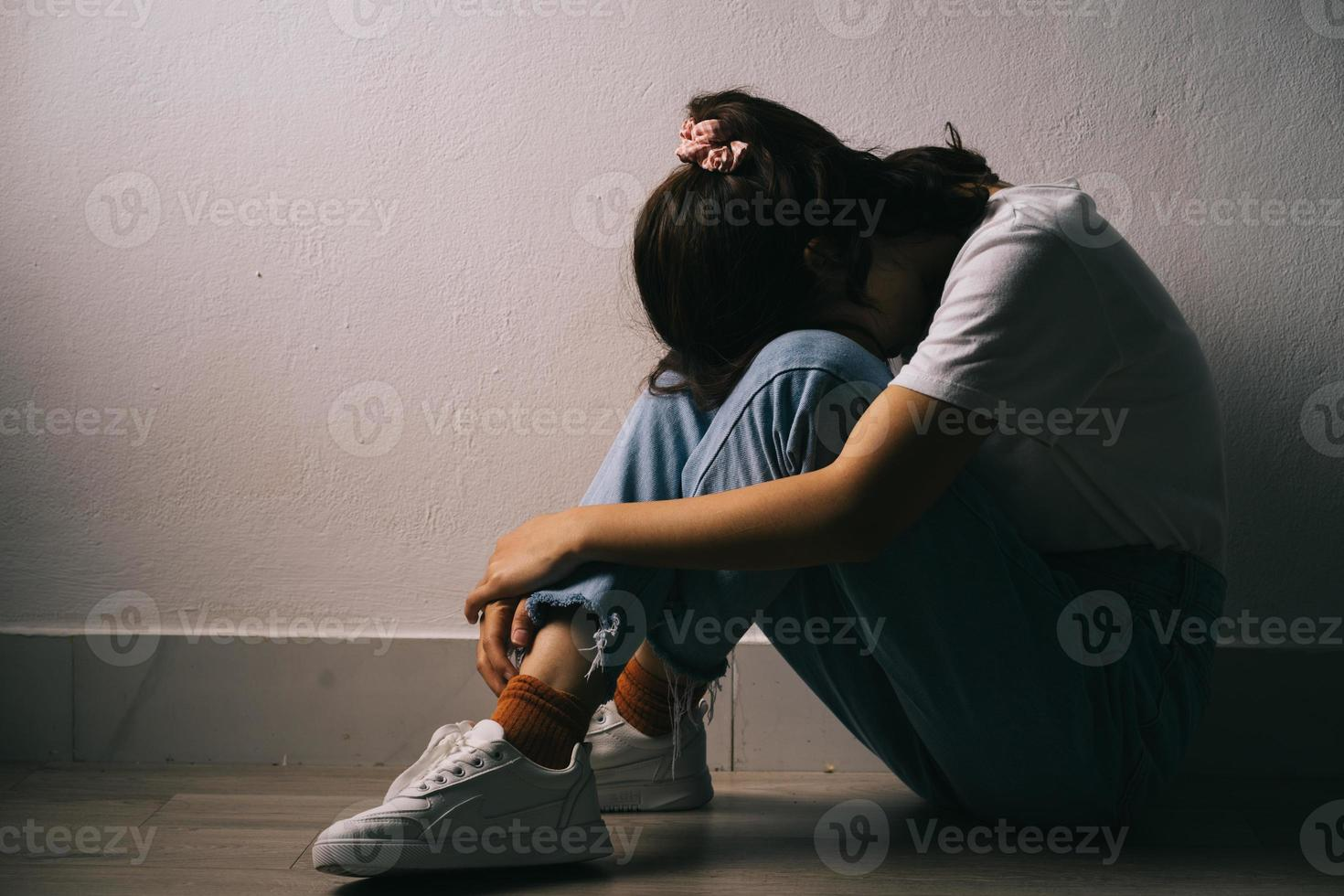 The young Asian girl is crying because she has a lot of pressure in her life photo