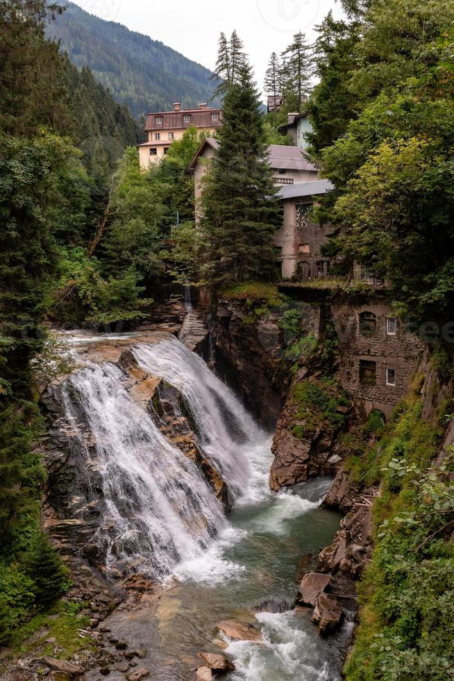 View of the old mill house and waterfall  in the Austrian city Bad Gastein. photo