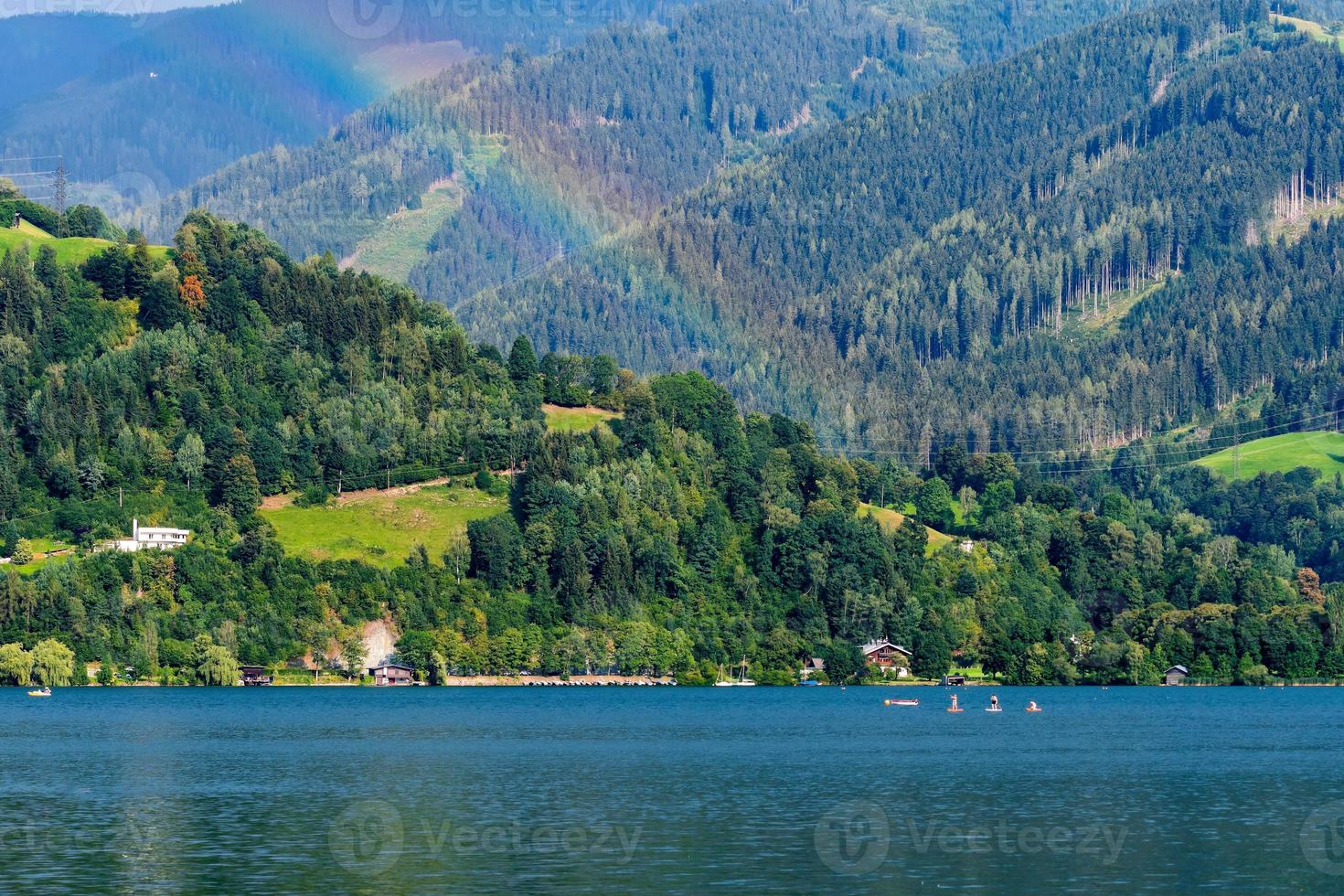 Landscape with a mountain lake and a rainbow. photo