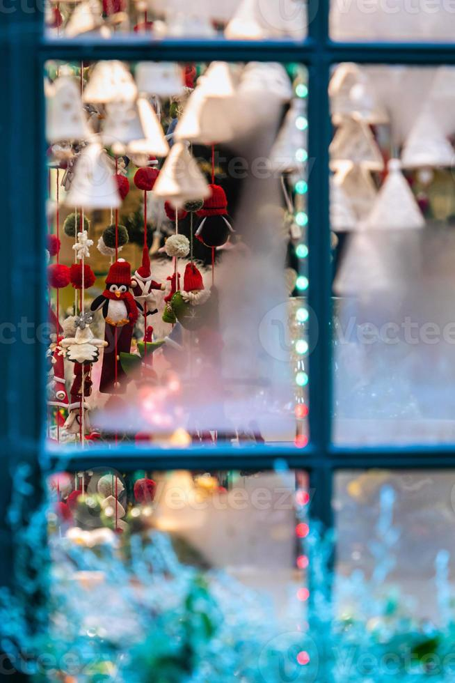 Frozen window panes through which visible Christmas decorations. The concept of Christmas time - image photo
