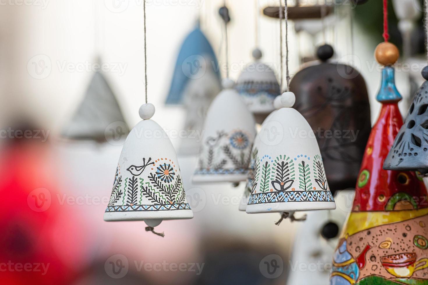 Christmas Ceramics Bell Decorations on Christmas Market at Riga, Latvia photo