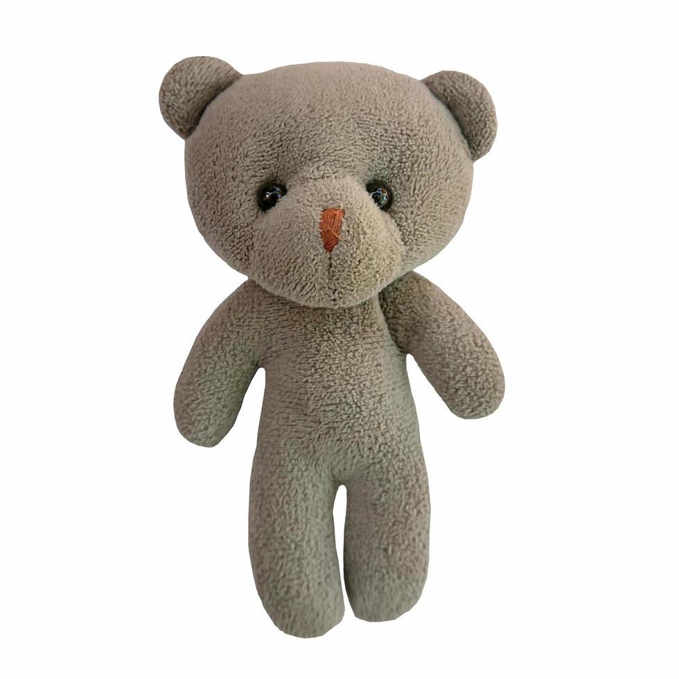 lindo muñeco oso sobre fondo blanco foto