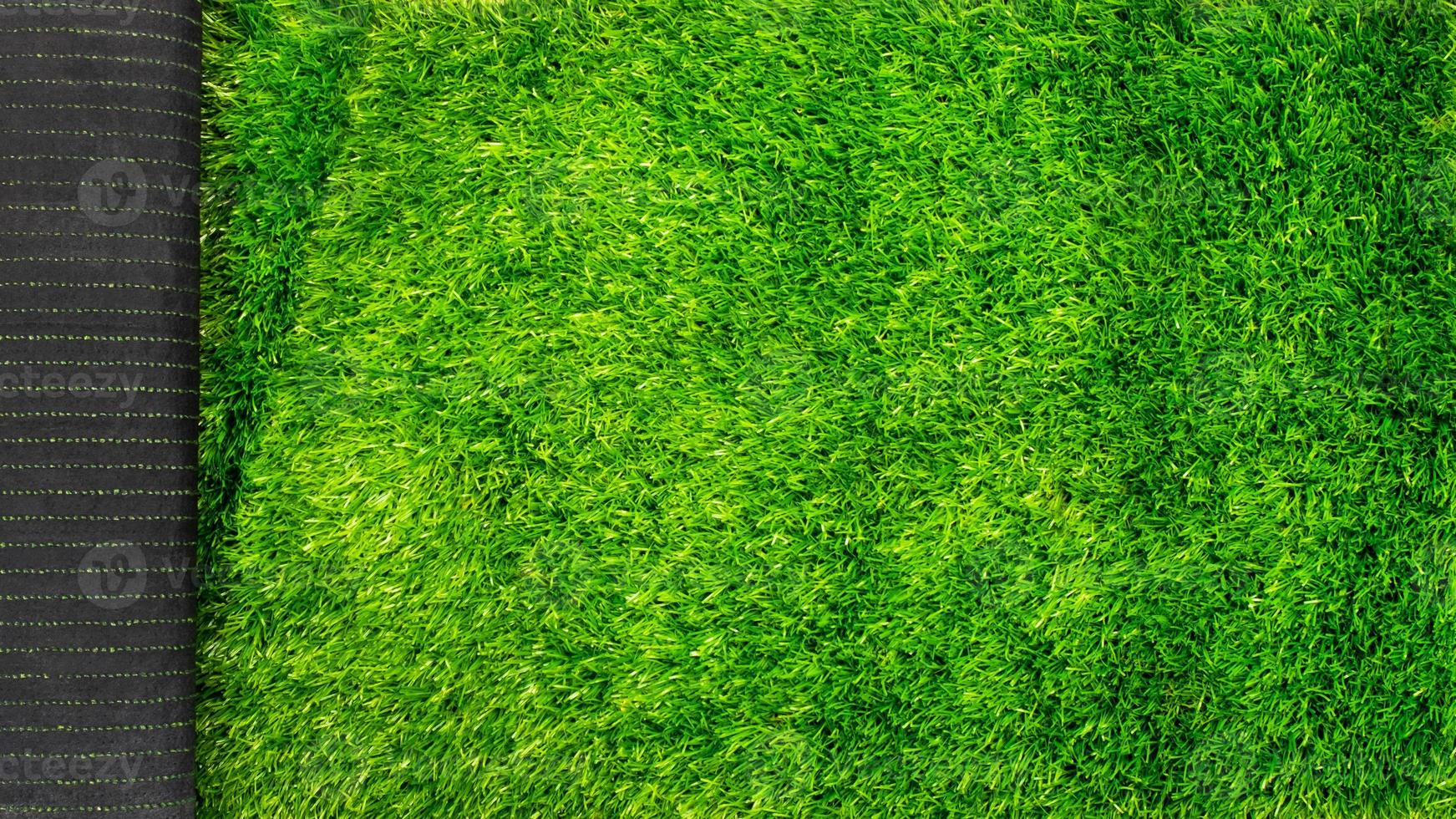artificial grass turf for sports fields green lawn mockup with copy space photo